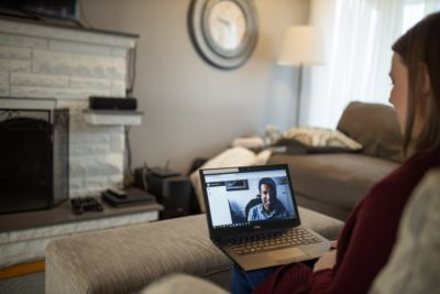 Woman telecommuting with laptop